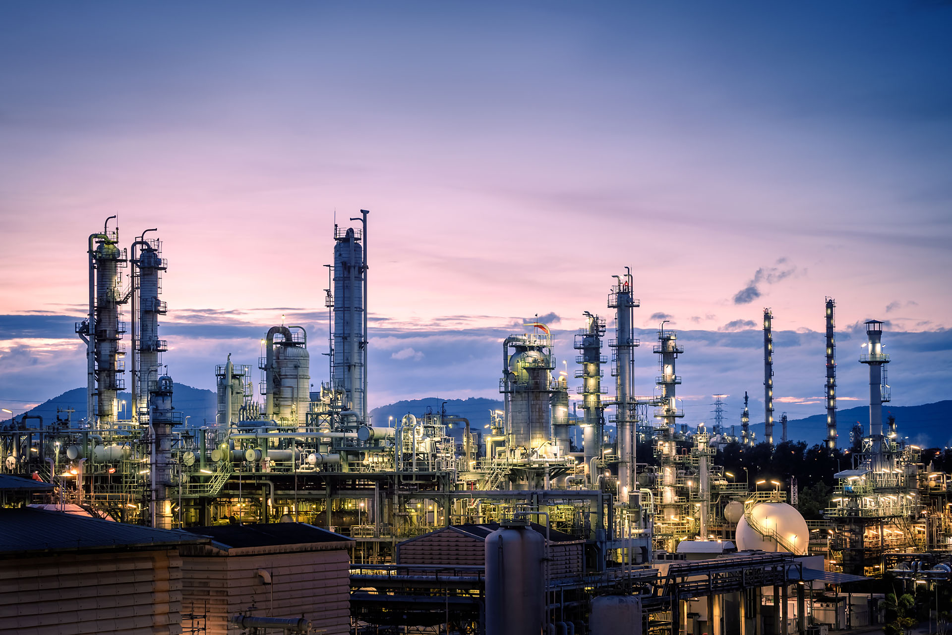 Manufacturing Of Petroleum Industrial Plant On Sky Twilight Back